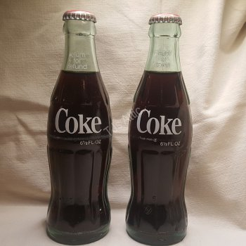 Full Unopened 6.5 Ounce Coca Cola Bottles