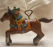 Tin Lithograph Metal Wind Up Cowboy With Lasso